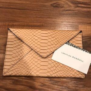 New Loeffler Randall envelope pye clutch in nude